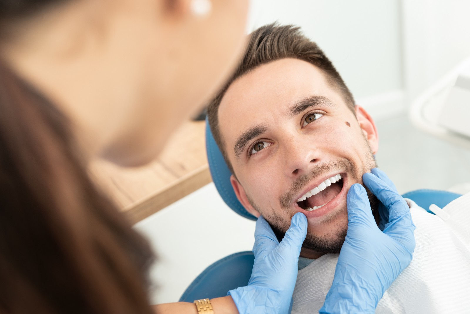 patient getting teeth examined
