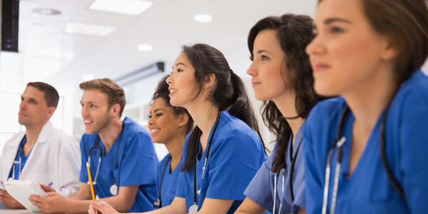 A group of medical students sitting in a line
