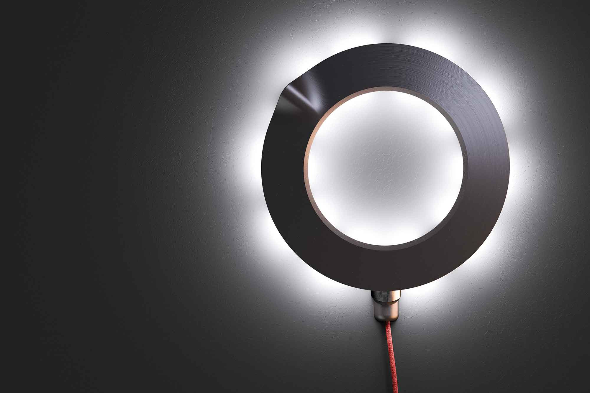 The wall lamp has LED lights on the inside and outside of the ring - If it is a significant memory, the light spreads across the room to indicate importance.