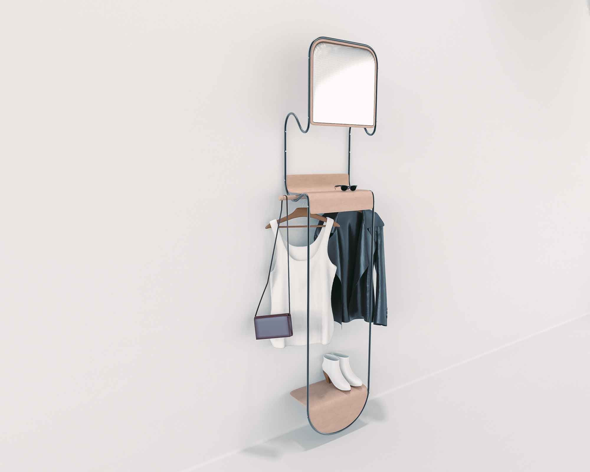 Kempt is designed around a CNC bent pipe fitted with two bent wood shelves. A hanger rod is inserted beneath the accessory shelf, which can also be installed underneath the mirror.