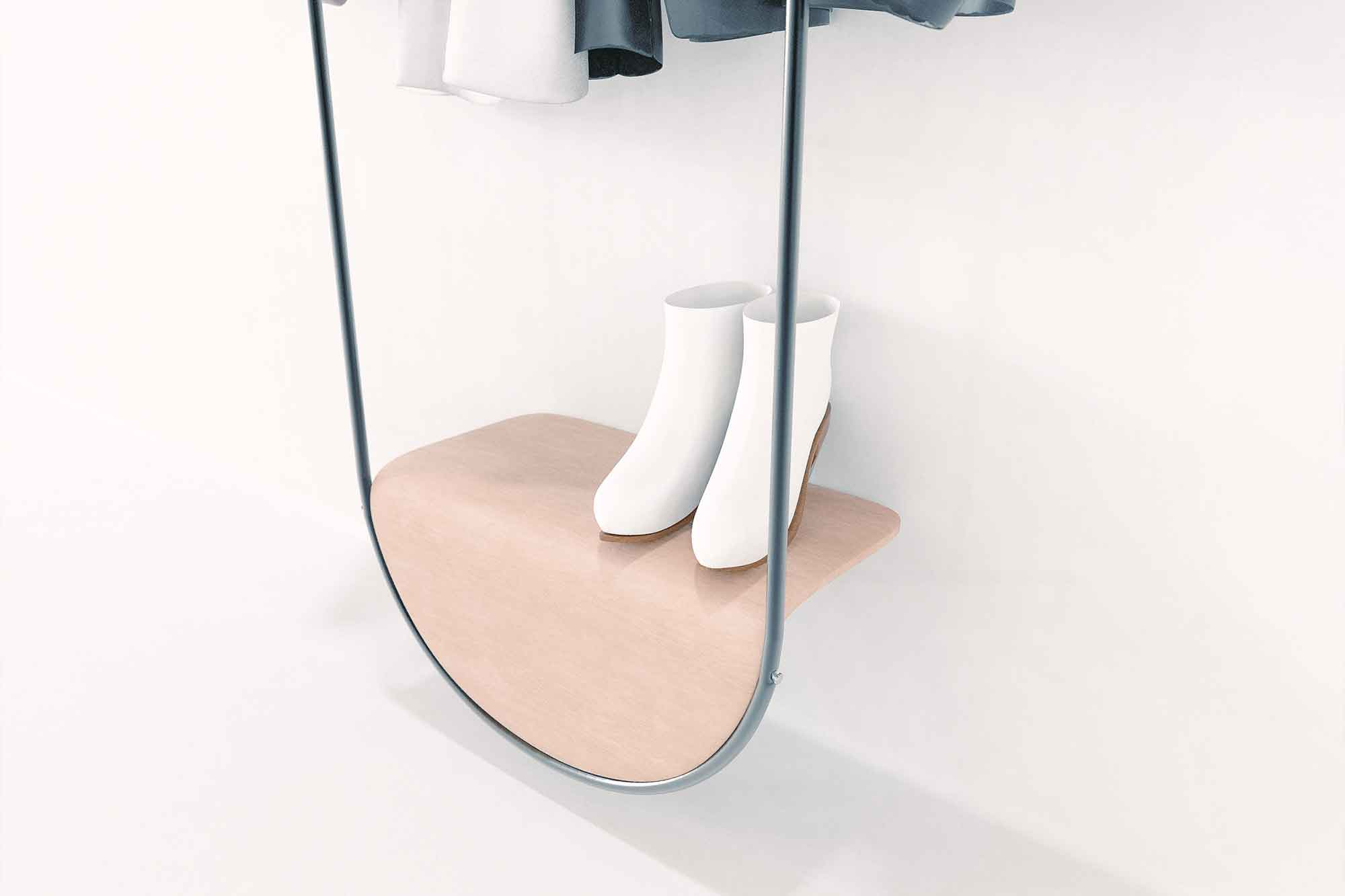 A lower shelf holds shoes off of the floor and stabilizes the bottom against the back of the wall.