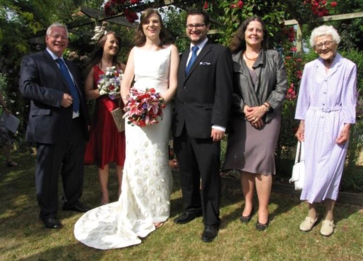 A family smiling at a wedding