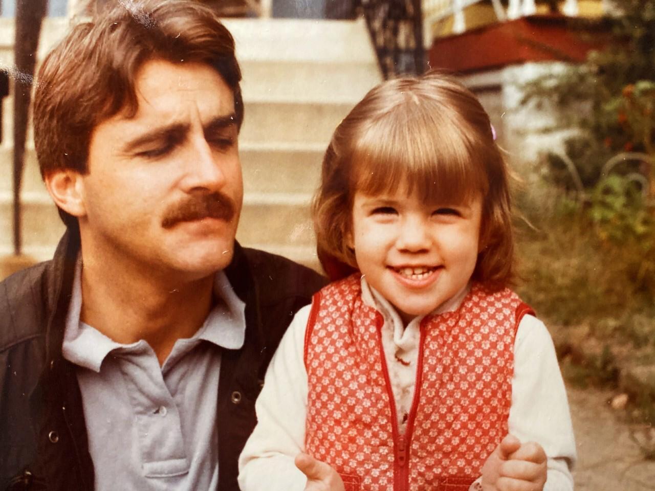 Man looking at daughter
