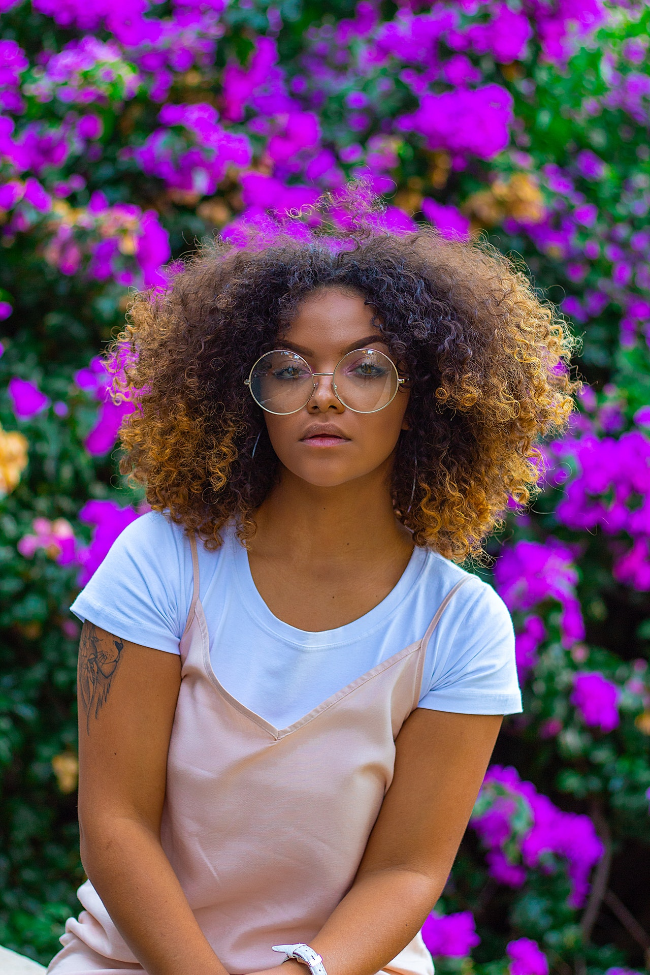 Young brown skinned lady wearing glasses
