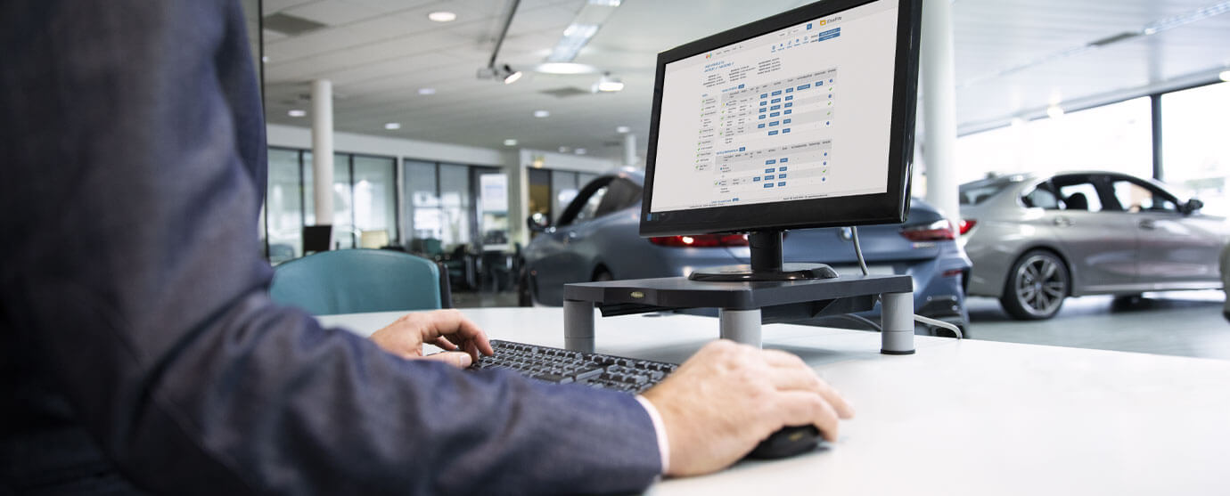 Close up of Sales Executive using iDealFile on a desktop computer in a showroom