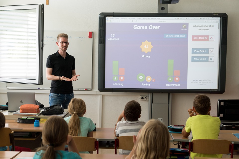 Teacher in the classroom using a smart board