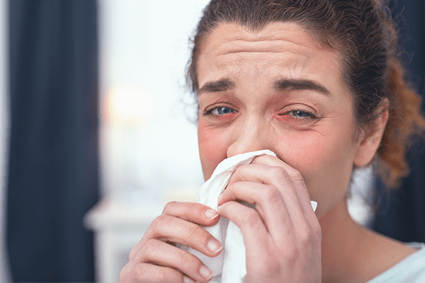 Woman suffering from upper respiratory congestion