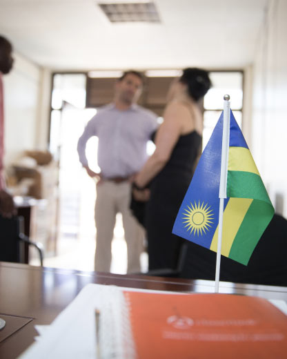 Kountable executives in an SME office in Kigali with the Rwandan flag in the foreground