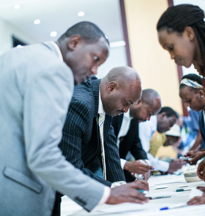 SME managing directors sign up to be participants in the Kountable platform at a launch party in Kigali, Rwanda
