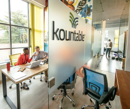 Kountabe employees collaborate in the colorful Nairobi, Kenya Kountable office