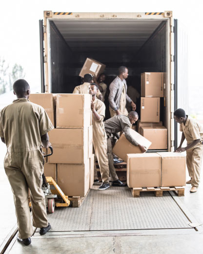 Africa Medical Supplier workers fulfilling a procurement shipment that has arrived to the warehouse