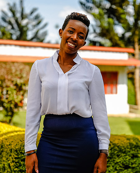 Portrait of Angeline Wibabara, Managing Director of ATIC in front of greenery in Rwanda