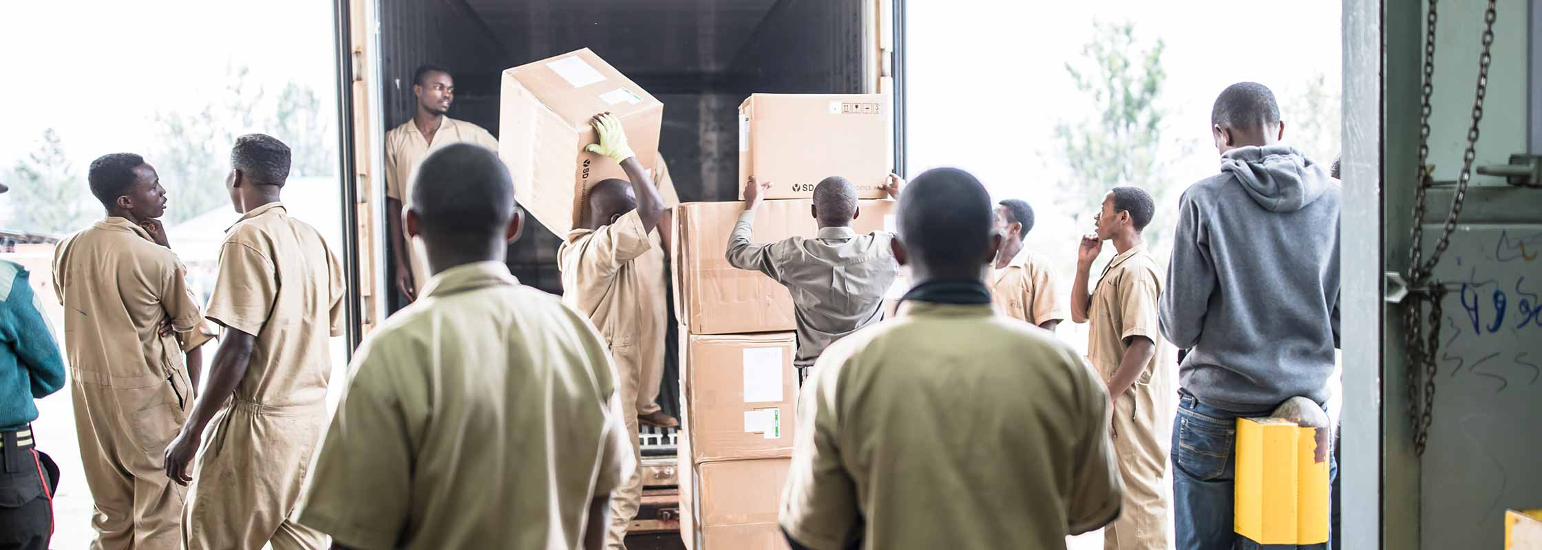 AMS workers fulfilling a procurement shipment that has arrived to the warehouse