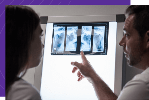 A medical specialist examines an Xray