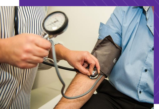 Doctor places stethoscope on patients arm