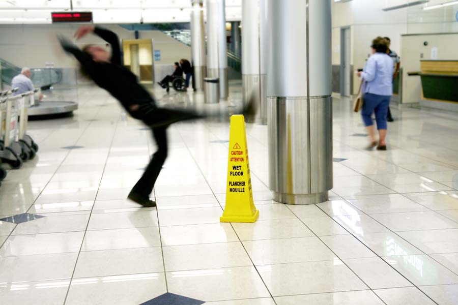 person slipping on wet floor