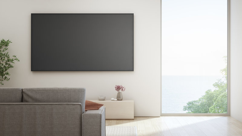 minimalist living area with black flat screen tv