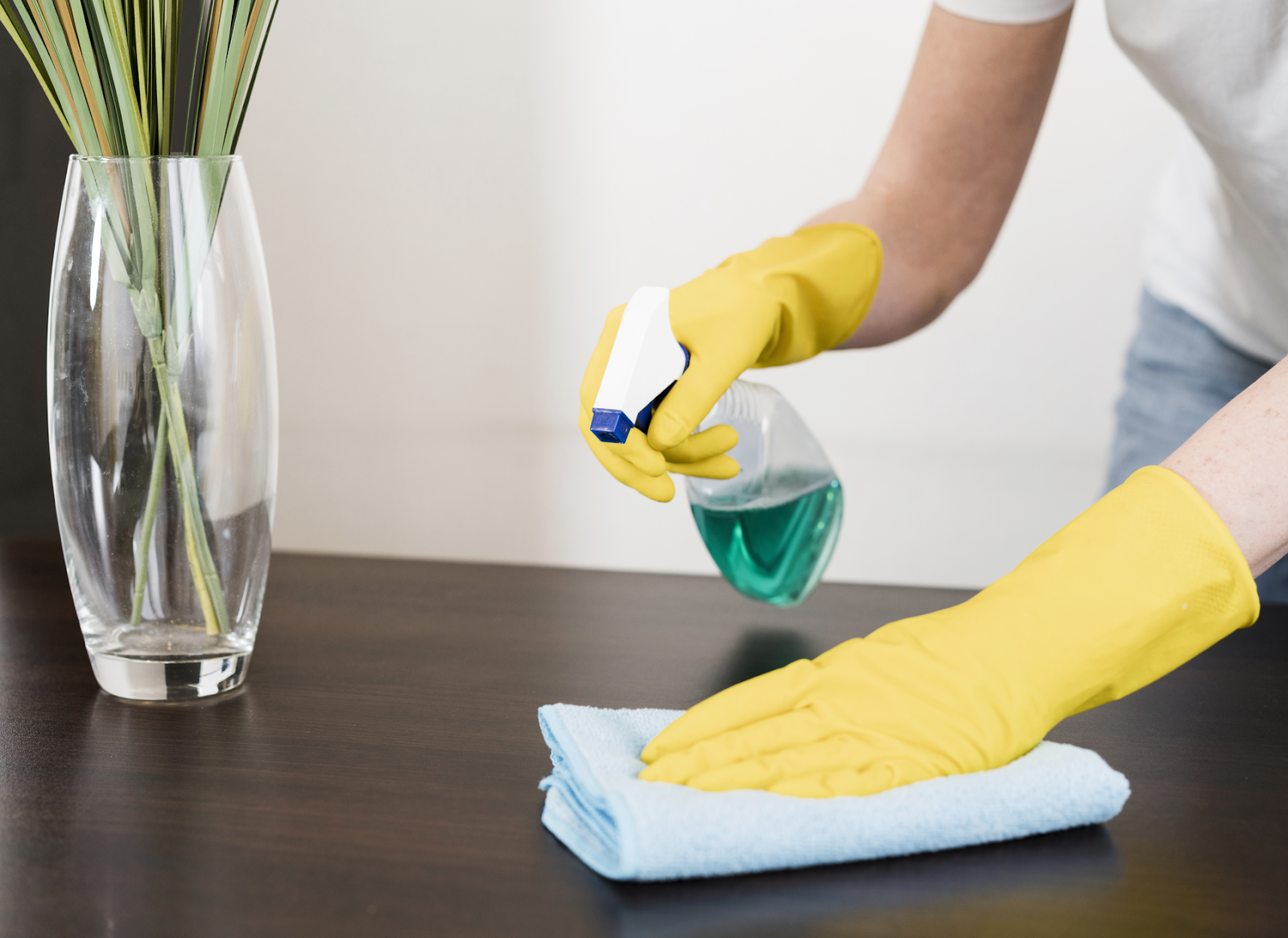 wiping and cleaning a table