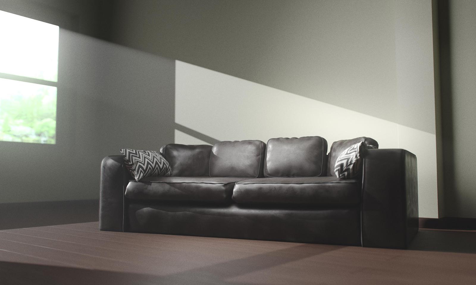 black sofa hit by sunlight