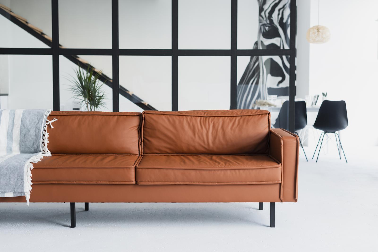 brown leather sofa on white flooring