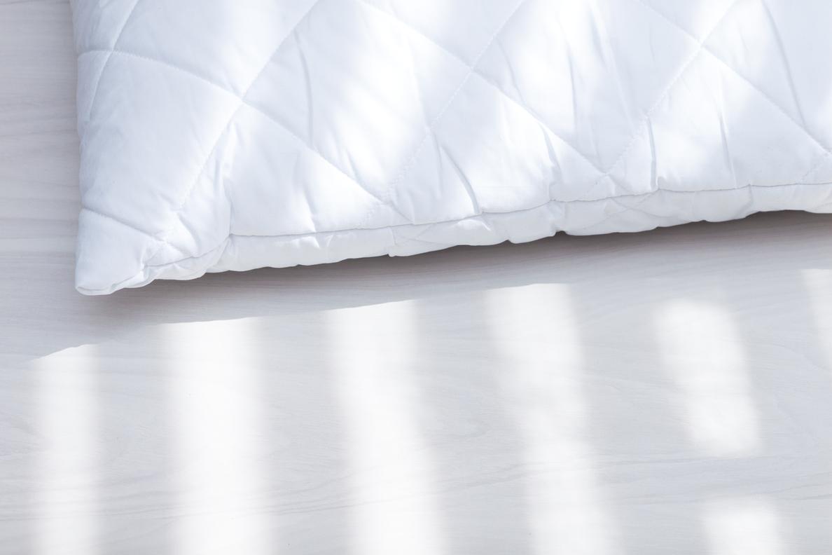 white polyester pillow on floor