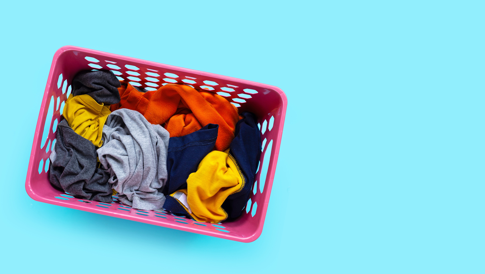 basket with dirty clothes for laundry
