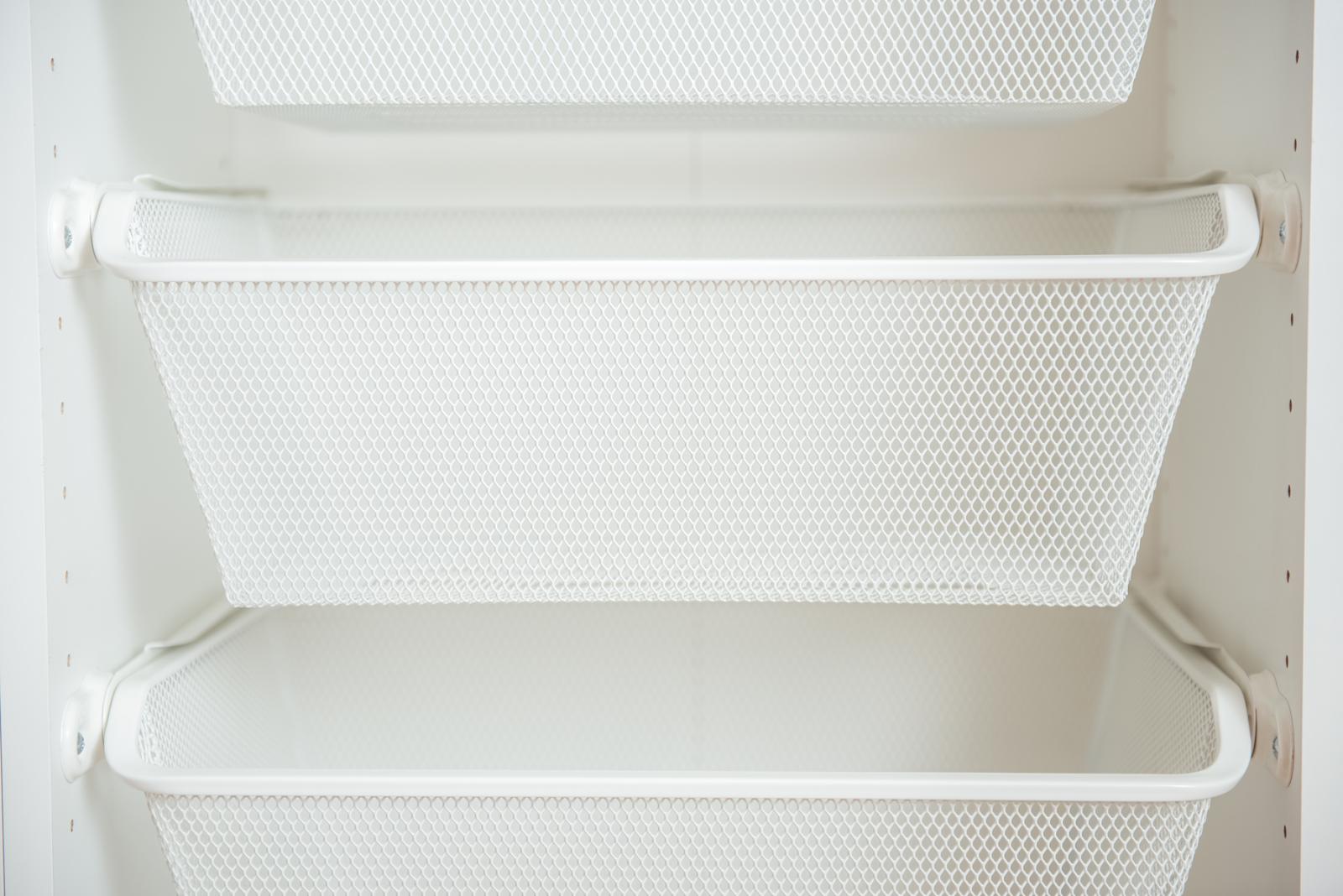 white baskets inside a closet
