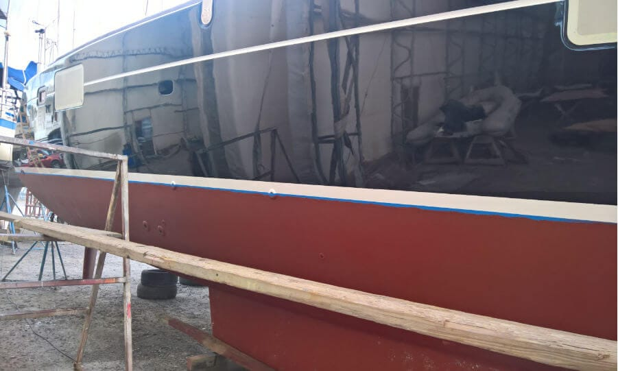 Side of a freshly painted yacht hull.