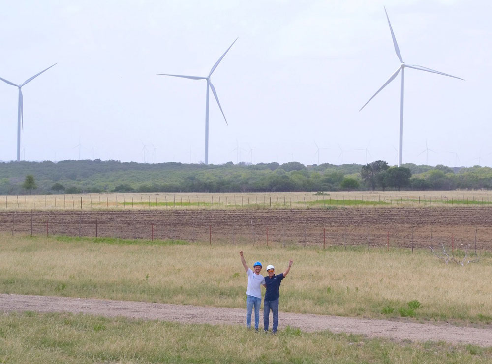Ignacio from Sterblue and Andrew from National Drone Pros in wind turbine lanscape in Texas