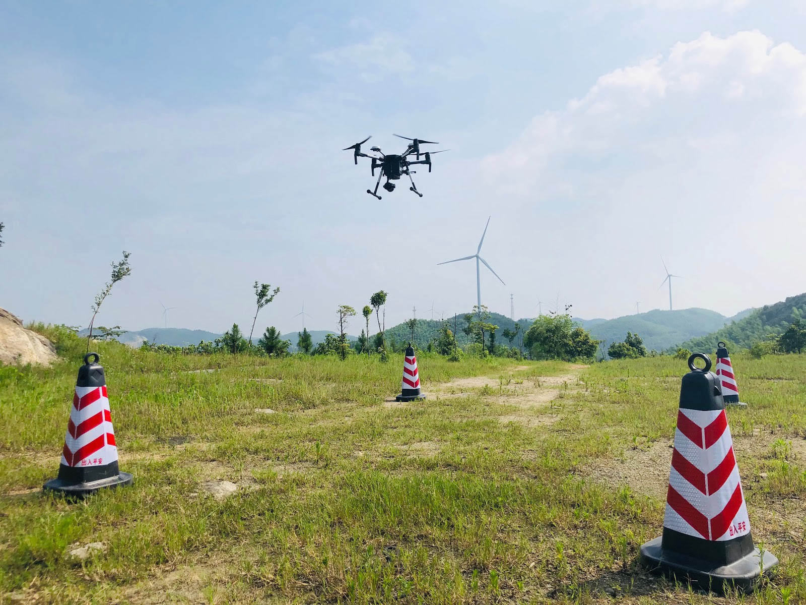 Drone flying arround wind turbines with drones in Yueyang