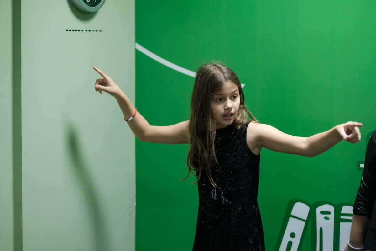 Girl pointing to the clues on the wall