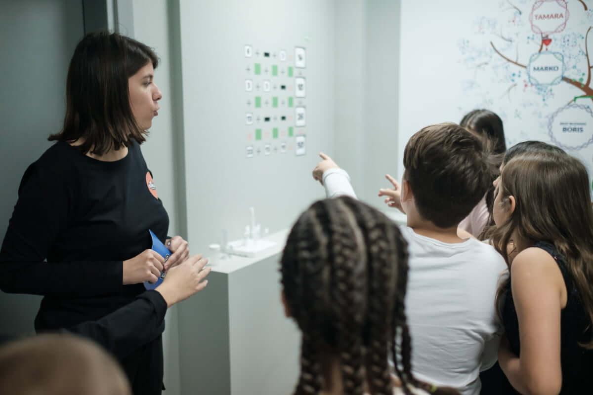 Woman talking to children
