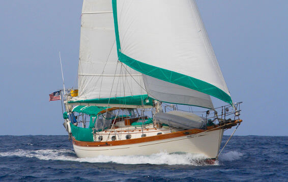 40 foot 1986 Ta Shing Tashiba sailing the ocean with two sails up