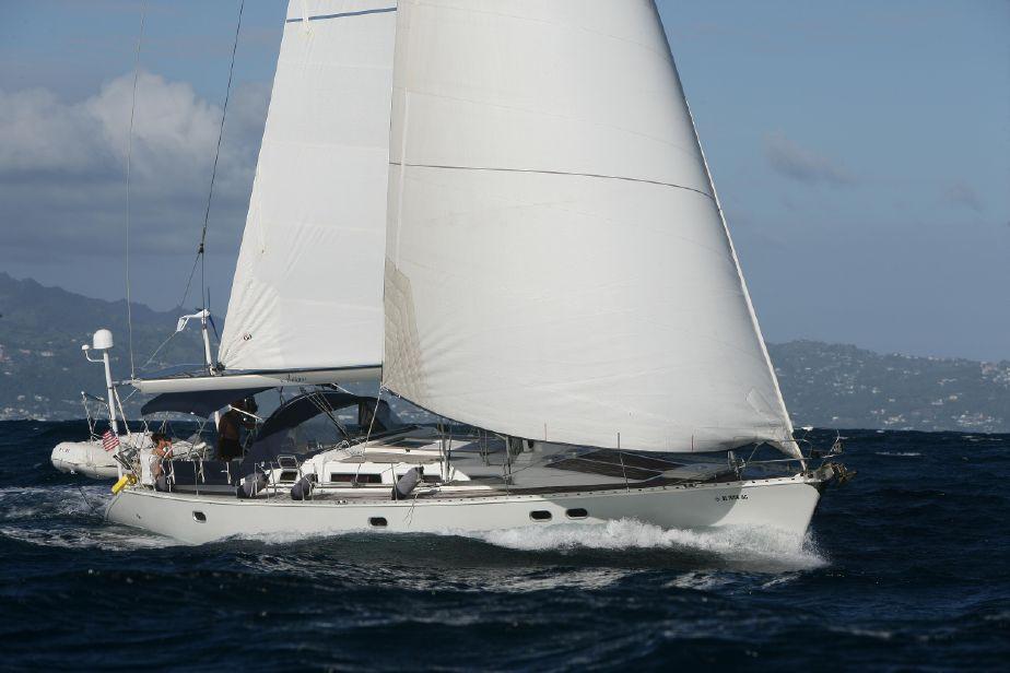 51 foot 1991 Jeanneau Sun Odyssey yacht in full sail cutting through the ocean