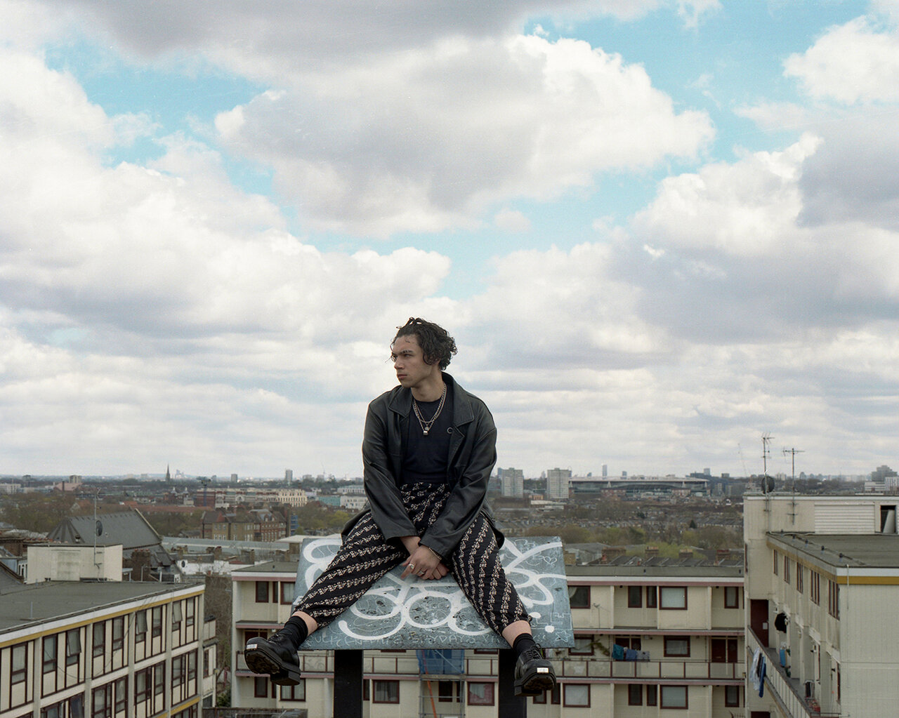 Man sitting on rug in the clouds