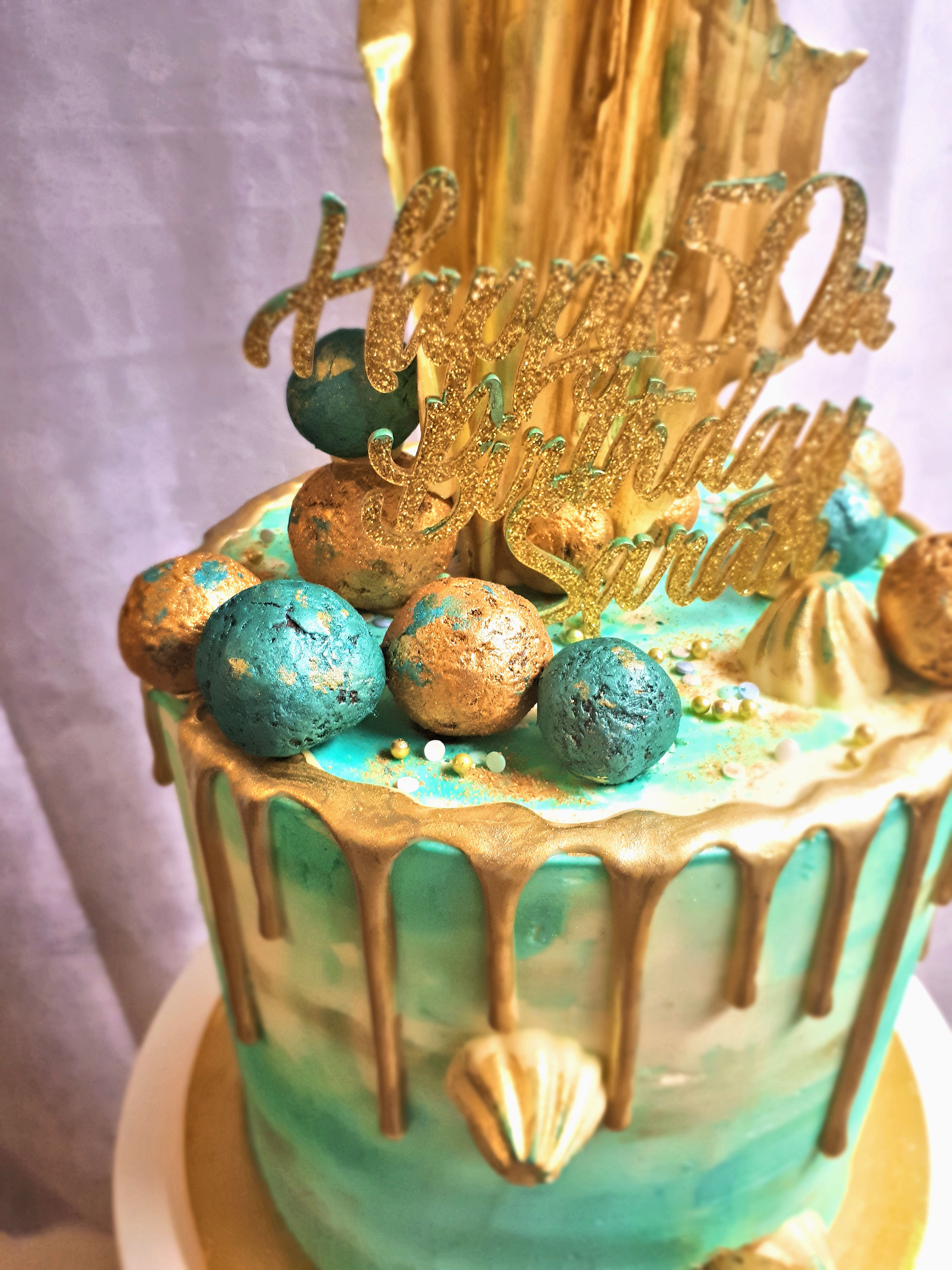 blue and gold buttercream drip cake