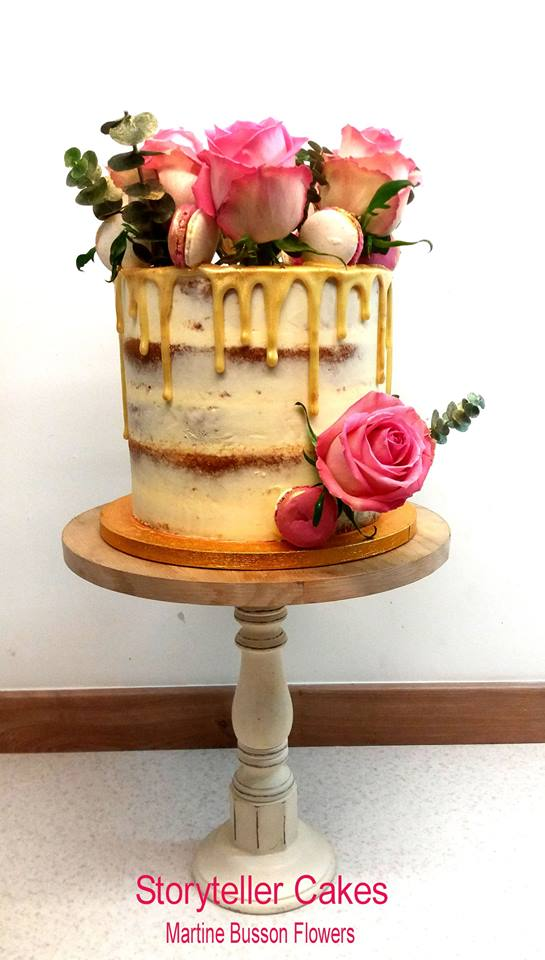 semi naked drip cake with fresh flowers