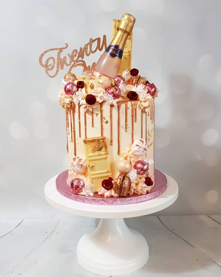pink and rose gold buttercream drip cake with champagne