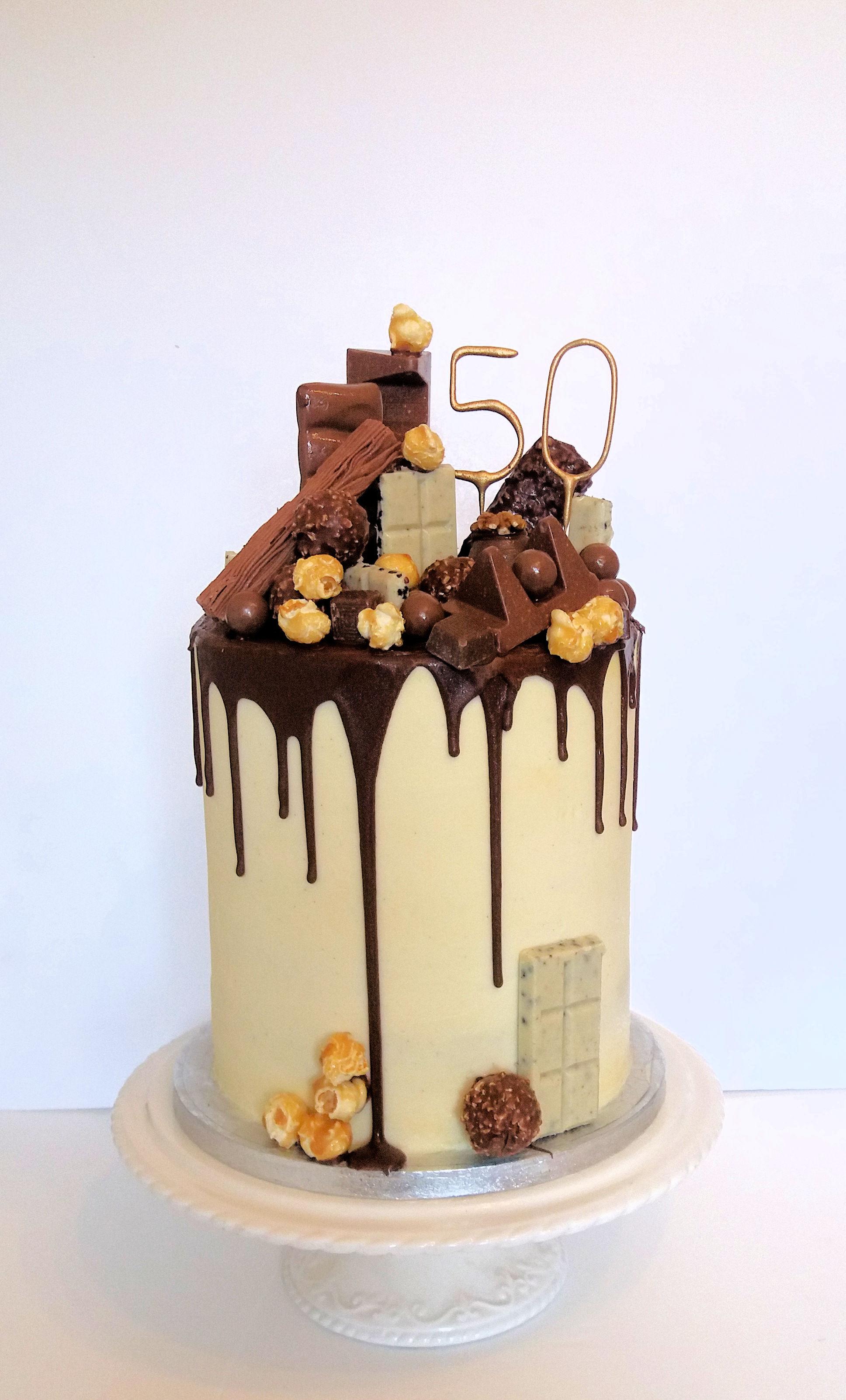 white chocolate buttercream drip birthday cake