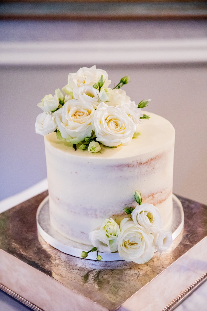 semi naked white wedding cake