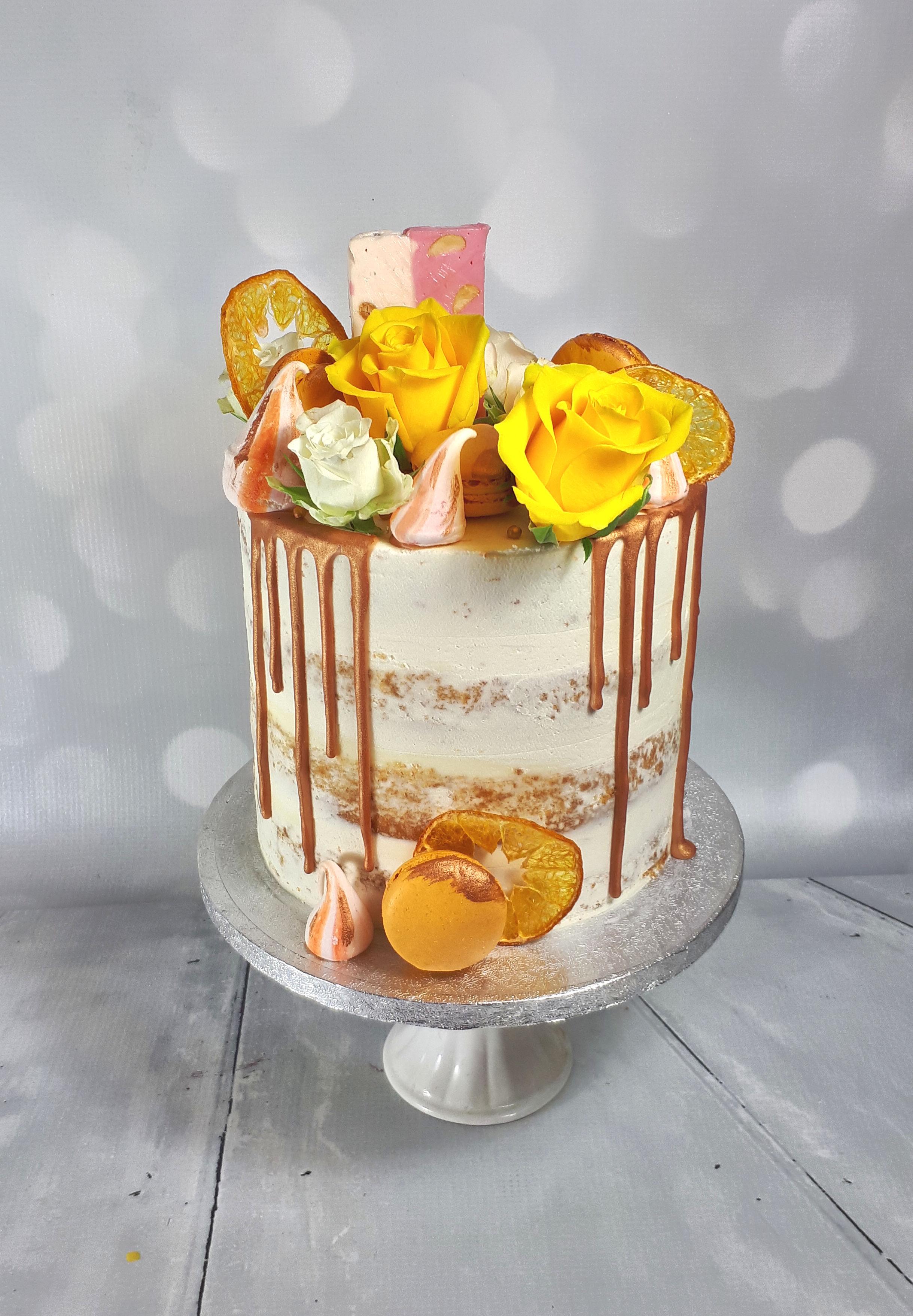 yellow and white buttercream drip birthday cake