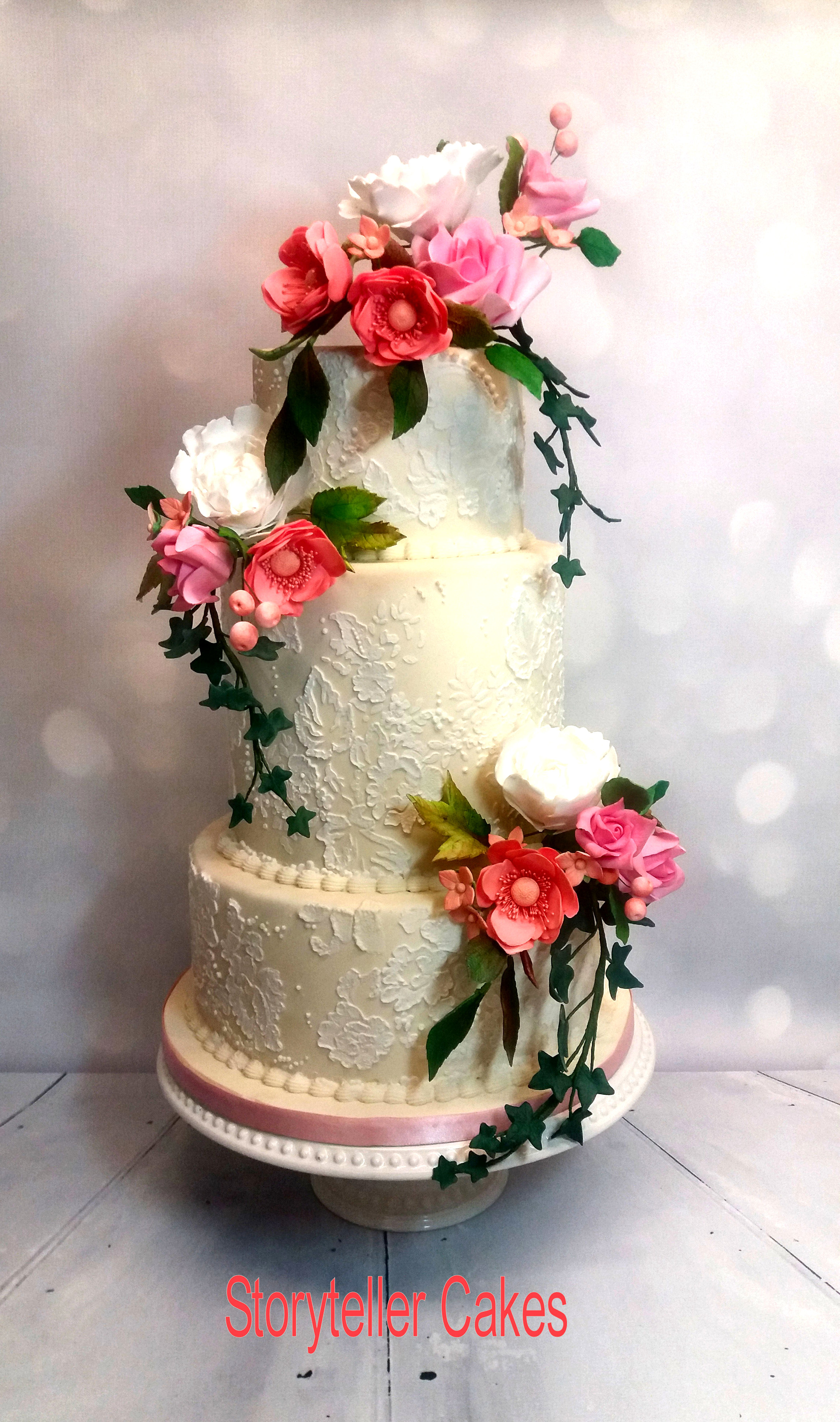 lace white and pink wedding cake