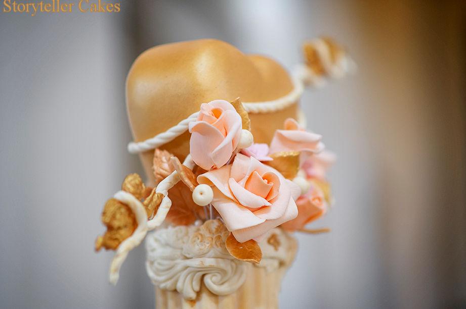 gold cherub wedding cake