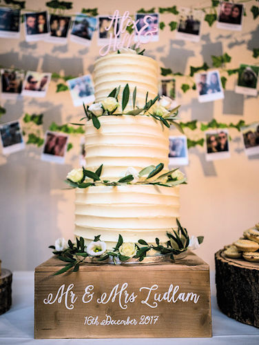 white buttercream and foliage wedding cake