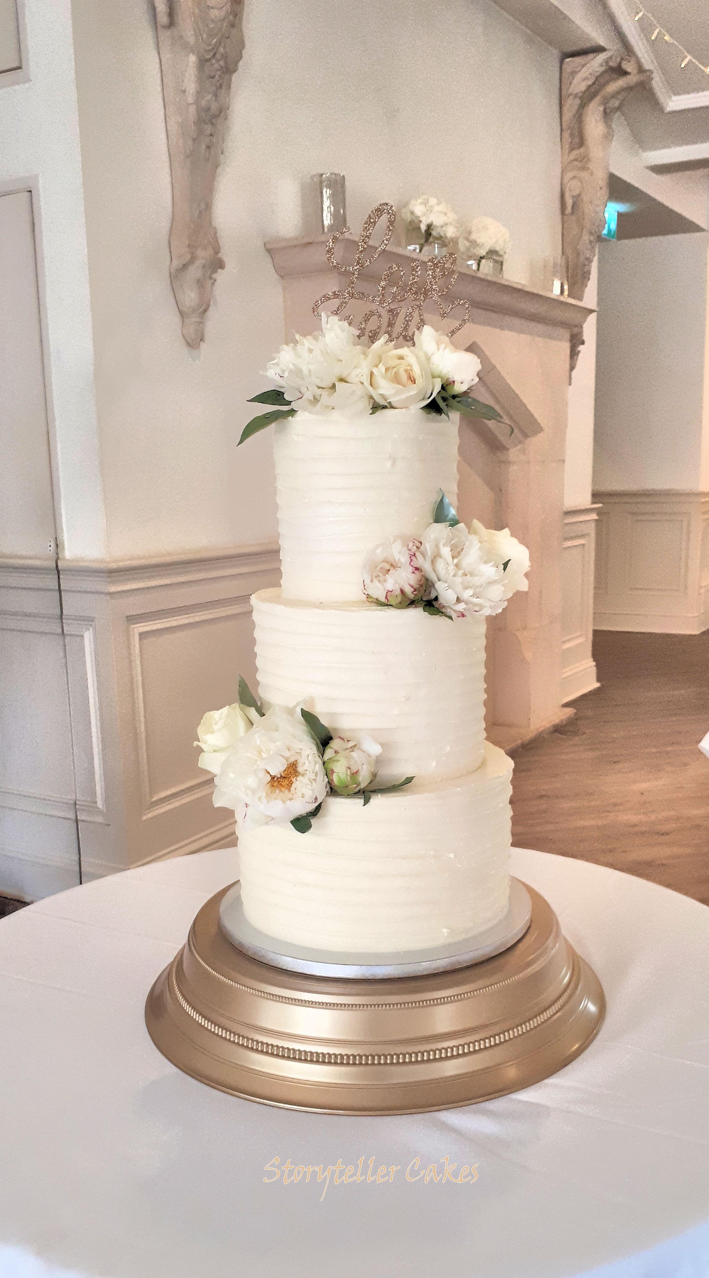 buttercream ruffle peony wedding cake