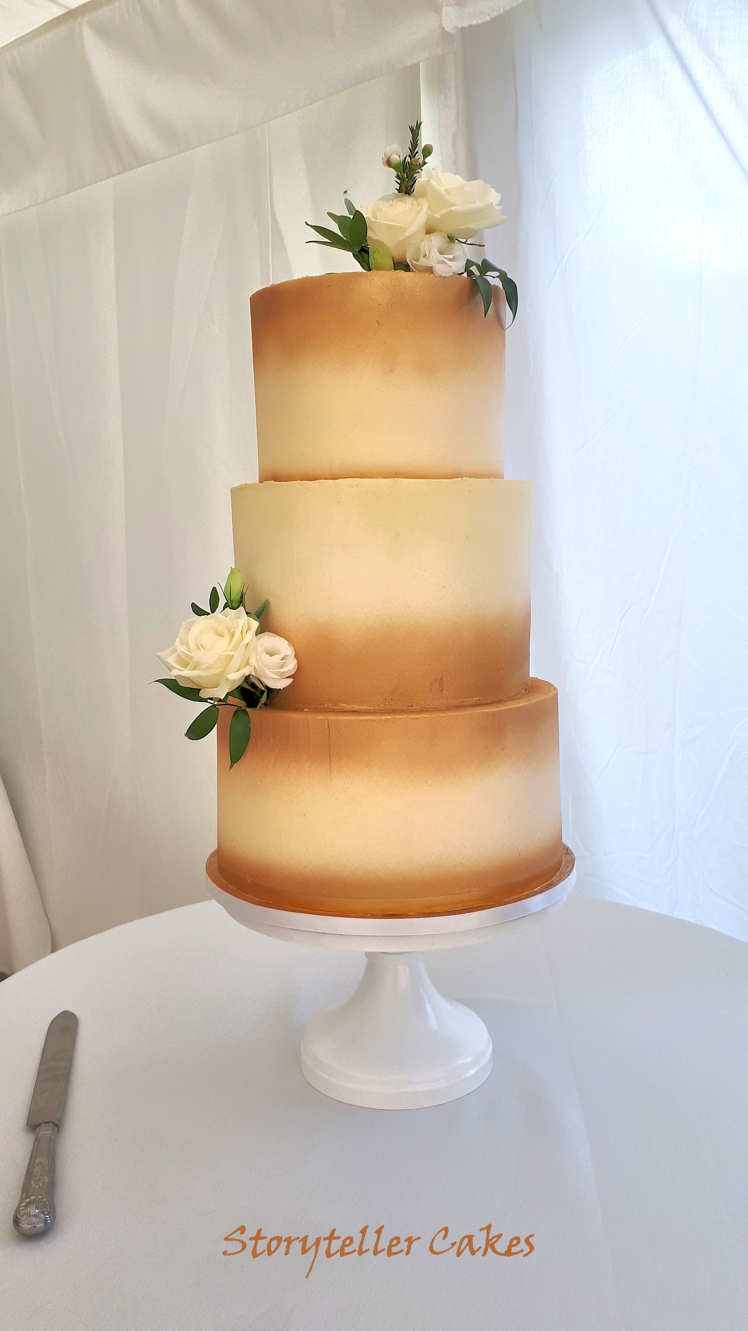 gold and white buttercream wedding cake