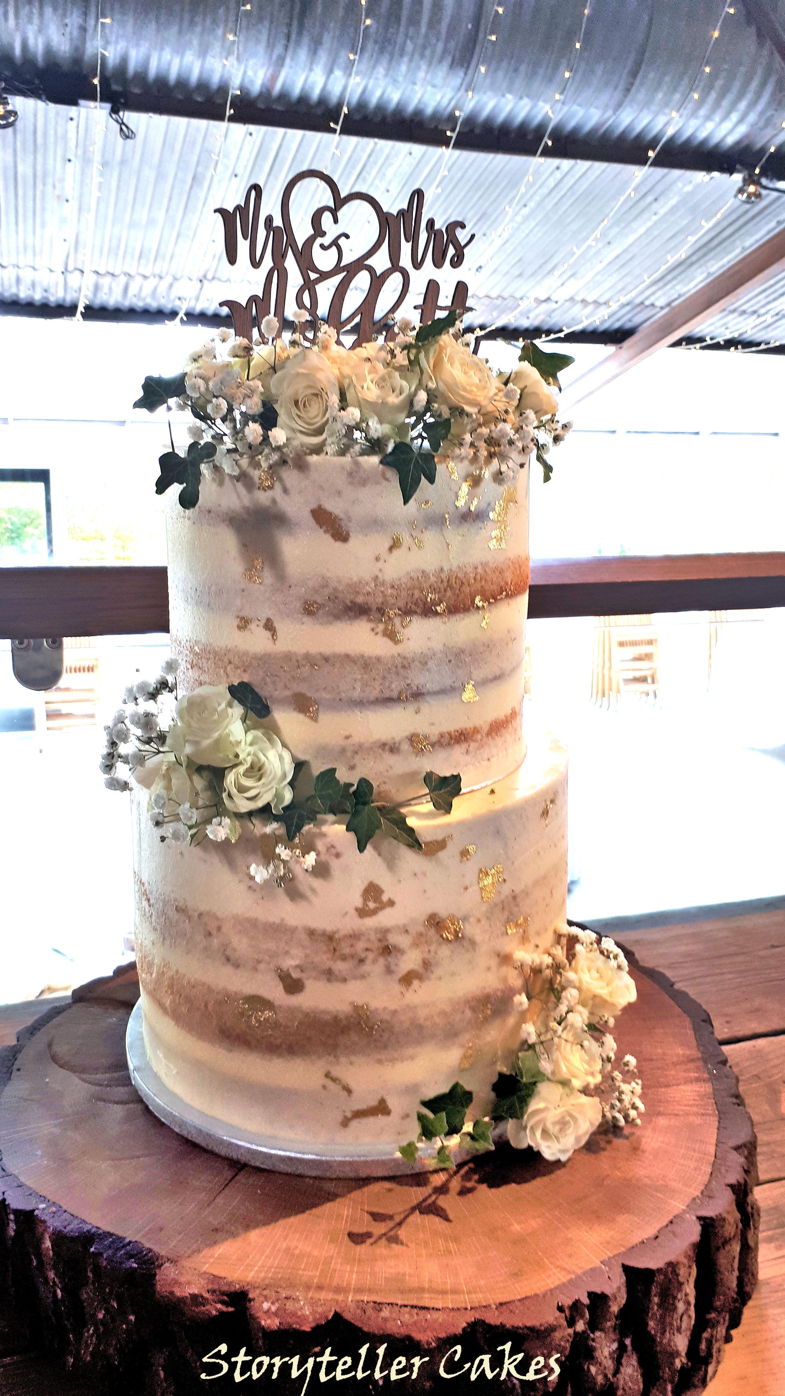 semi naked white rose wedding cake