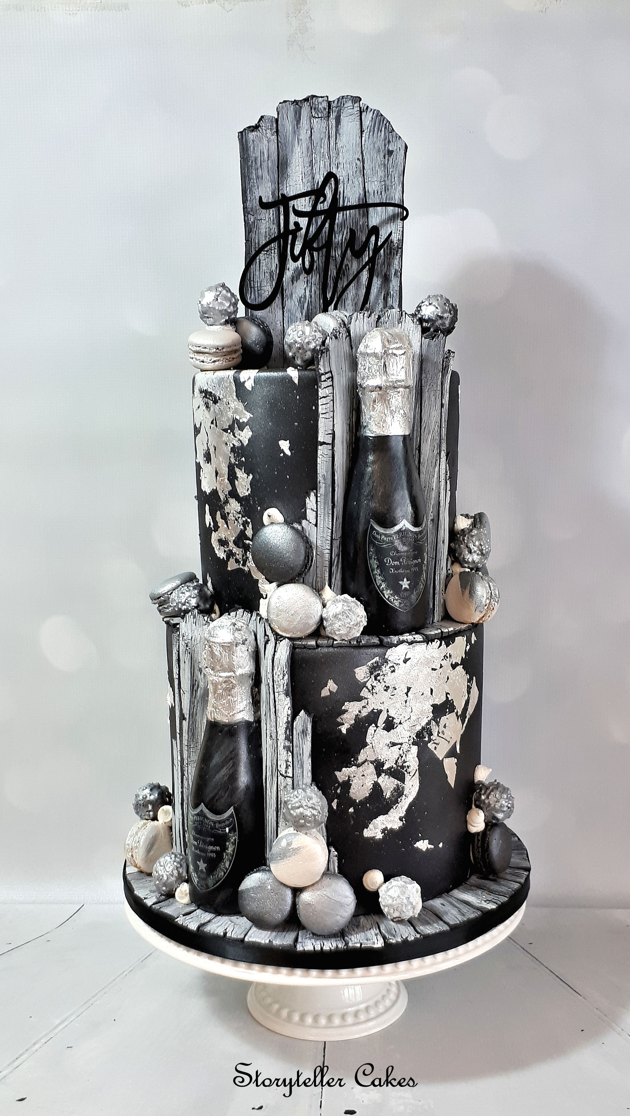 50th black white and silver champagne cake