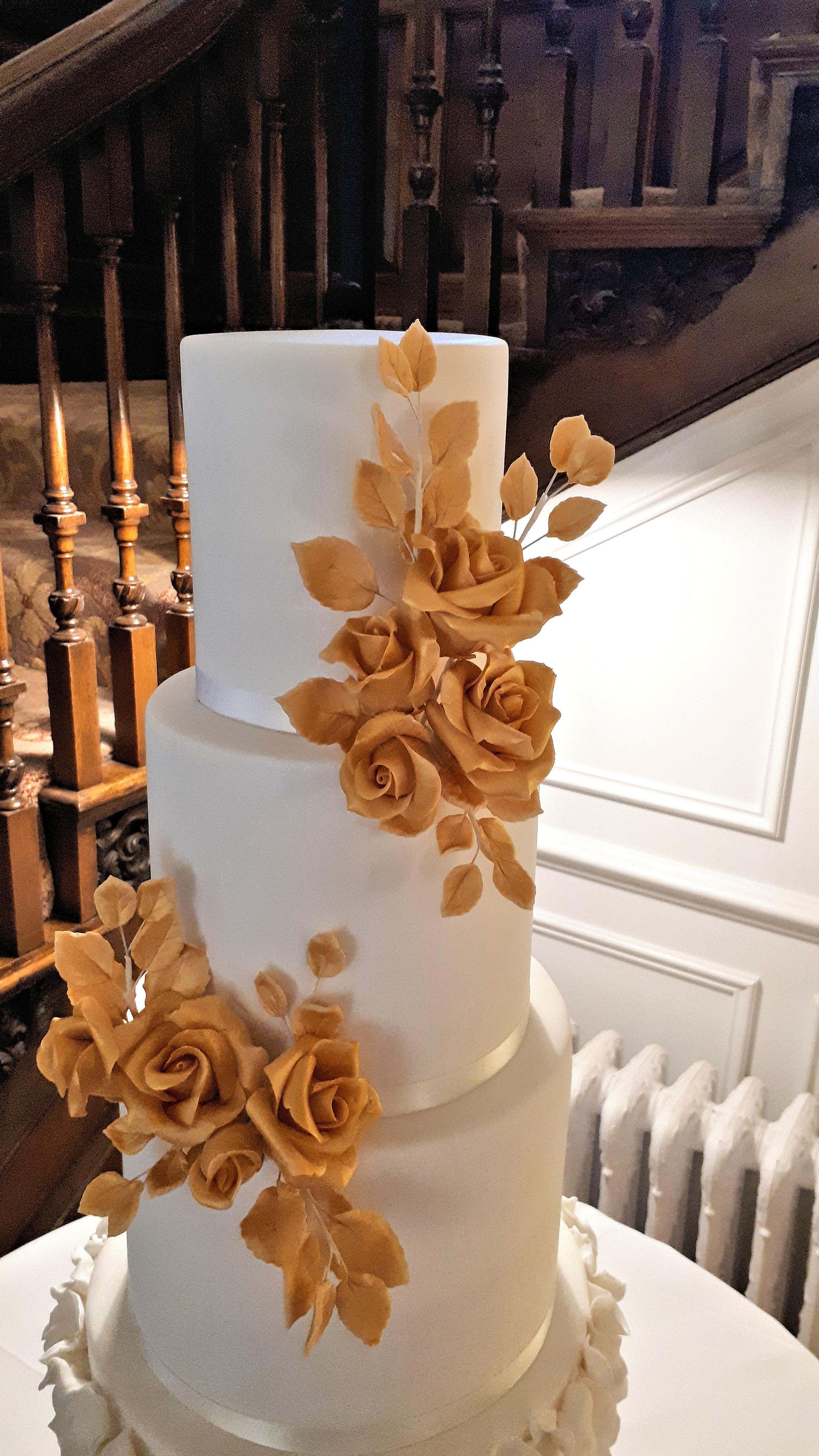 White Wedding Cake with Gold Roses