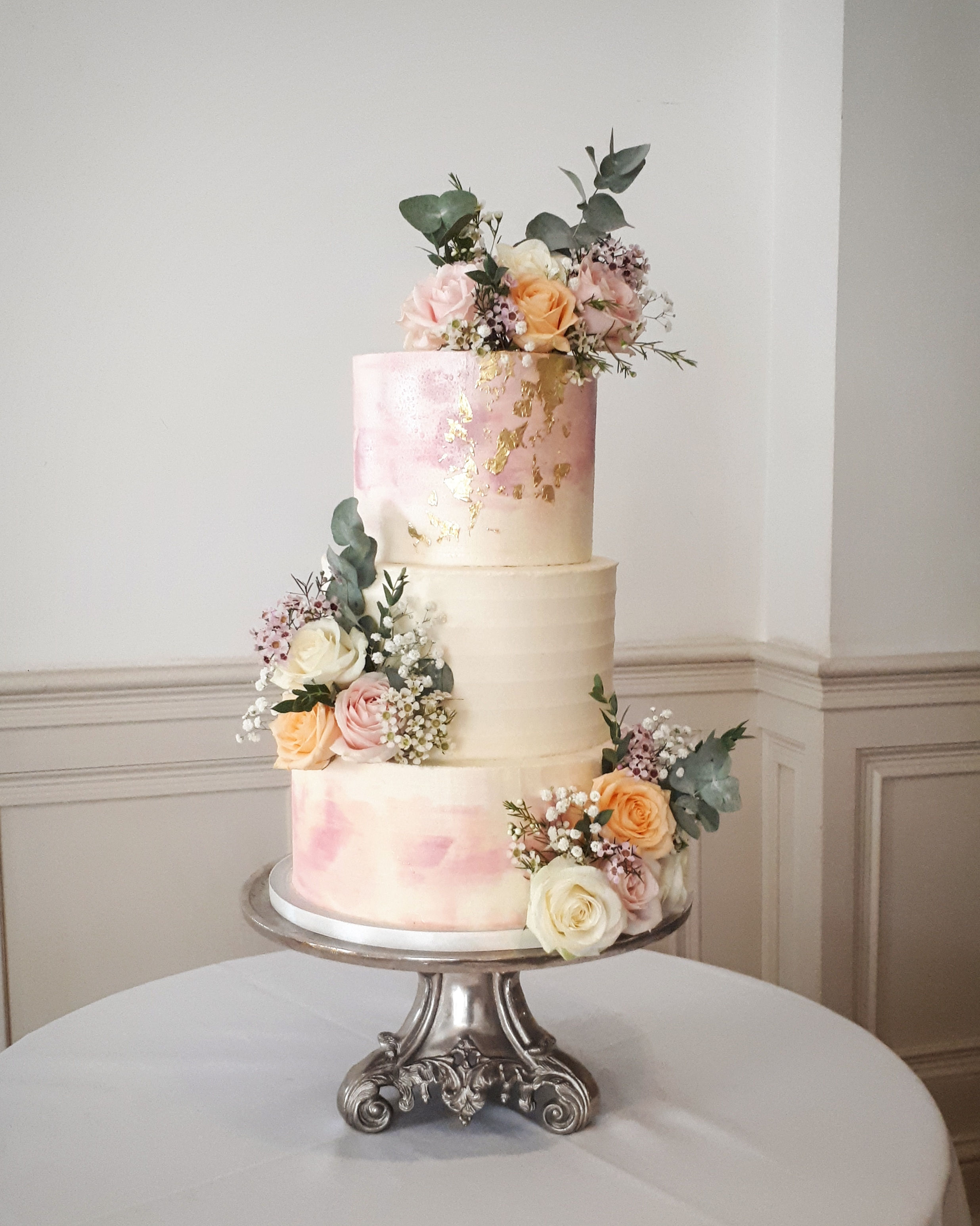 peach pink buttercream wedding Cake with fresh flowers